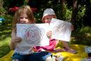 Children creating art in the garden