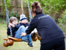 nanny with children in the garden
