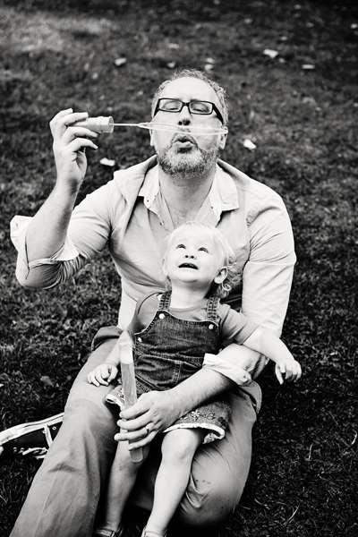Father and daughter playing with bubbles