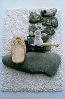 Sandals, candlestand and pebbles